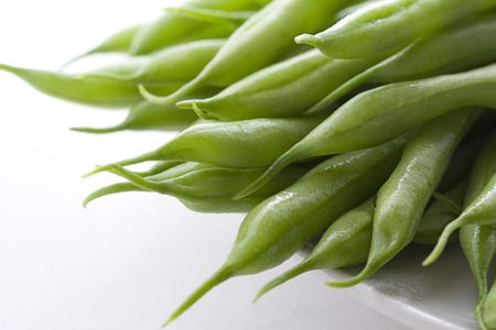 Close up of green beans on white back ground. photo
