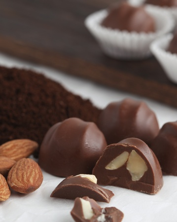 Chocolate nut truffles with ingredients in background.