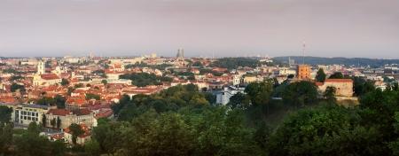 Green town panorama at sun rise photo