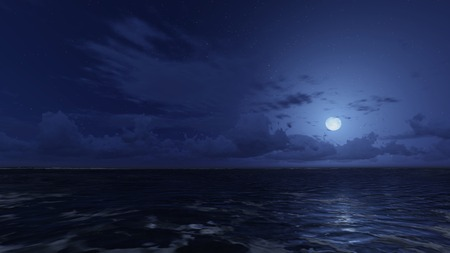 stargazing: Calm ocean under starry night sky. Moonlight on the ocean surface Stock Photo