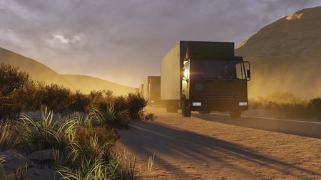 autotruck: Military trucks on a desert road at sunset
