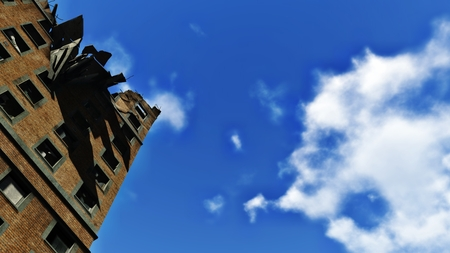 ravage: Ruined residential building against blue sky Stock Photo