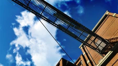bulkhead: Metal gangway against blue cloudy sky