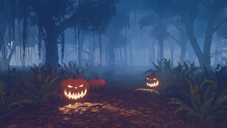 eerie: Halloween pumpkins on the forest trail at misty night