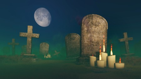 lighted: Lighted candles near the old gravestone at spooky night cemetery