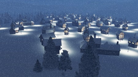 Top-down view on a dreamlike snowbound township at snowfall during nighttime Stock Photo