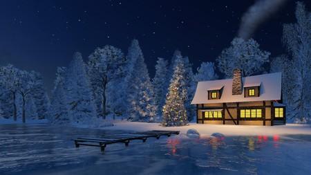 굴뚝 흡연과 소박한 집 조명과 별이 빛나는 밤 하늘 아래 얼어 붙은 호수의 해안에 크리스마스 트리 장식
