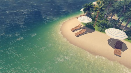 topdown: Top-down view on sandy tropical beach with palm trees, sunbeds and parasols at daytime