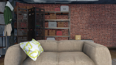 Close-up of a beige sofa against a rough brown brick wall in a modern loft apartment living room interior
