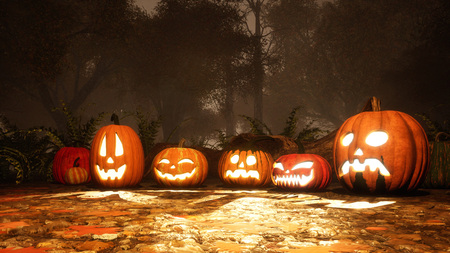 Close up of various Jack-o-lantern carved halloween pumpkins on a ground covered by fallen autumn leaves in misty forest at dusk or night. Festive 3D illustration from my own 3D rendering file.
