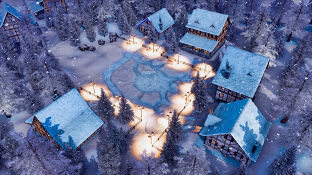 Overhead view of cozy snowbound european township high in snowy alpine mountains with traditional half-timbered houses at snowfall winter night.