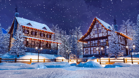 Cozy snowbound alpine mountain town with traditional european half-timbered houses and christmas lights at snowfall winter night.