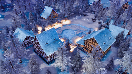 Top down view of cozy snow covered european village high in snowy alpine mountains with half-timbered houses at snowfall winter night.