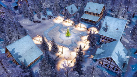 Top down view of snow covered european village high in alpine mountains with half-timbered houses and decorated Christmas tree at snowfall winter night. Imagens