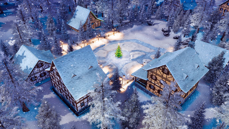Overhead view of snowbound european township high in snowy alpine mountains with half-timbered houses and decorated Christmas tree at snowfall winter night.