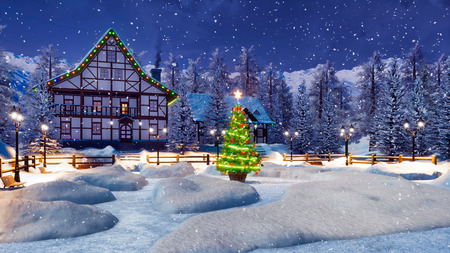 Cozy snowbound alpine mountain town with illuminated half-timbered houses and decorated Christmas tree at magical winter night during snowfall. Imagens