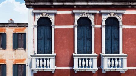 Old cracked exterior wall of ancient venetian building with small balconies. With no people realistic 3D illustration from my own 3D rendering file. Imagens - 128085886