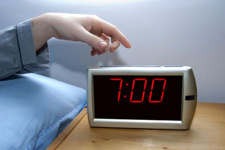 arouse: switch off an alarm clock Stock Photo