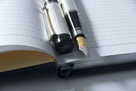 fountain pen on a blank diary over a desk Stock Photo - 6775329