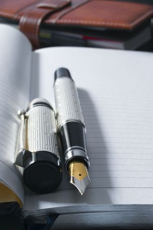 fountain pen on a blank diary over a desk Stock Photo - 6775328