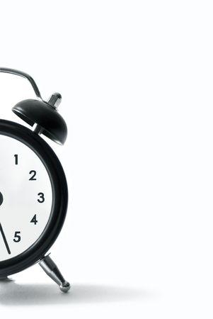 an alarm clock on white background photo