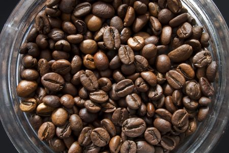 many Coffee beans into a jar of glass  photo