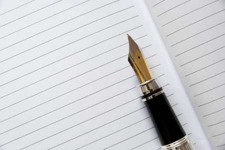 fountain pen on a blank diary Stock Photo - 6775333