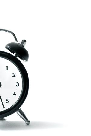 Alarm clock, an old style alarm clock on white background photo