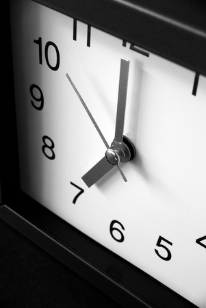 morning noon and night: a close-up of a clock on dark background , 7.00 0clock