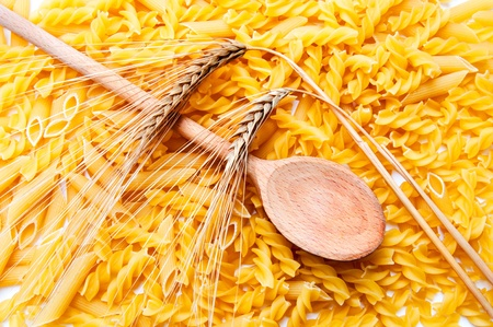 pasta, wooden spoon and a ear of wheat , Mediterranean diet photo
