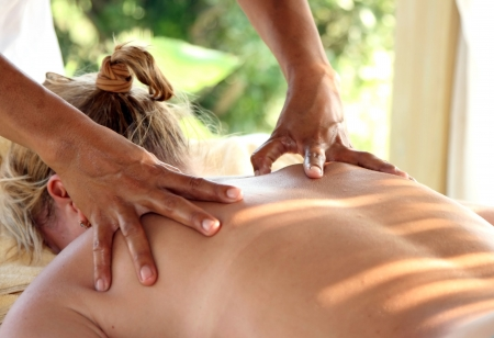 back rub: To the girl do massage of back Stock Photo