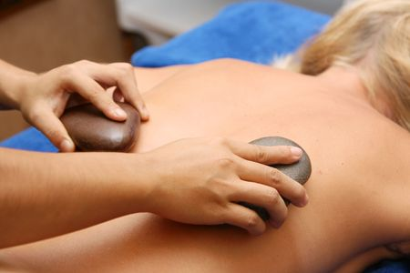 special volcanic stone massage session at a spa center Stock Photo