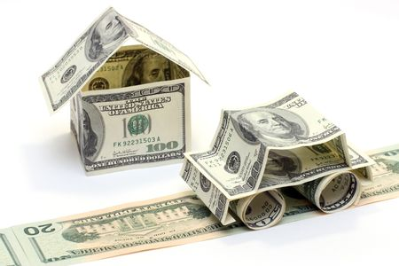 car loans: The car and the house made of Dollars Stock Photo