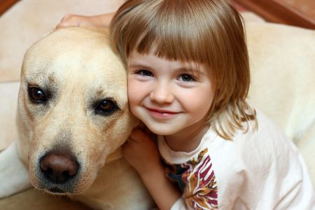 The little girl with a dog photo