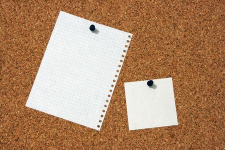 The pure pieces of paper, enclosed to corkboard photo