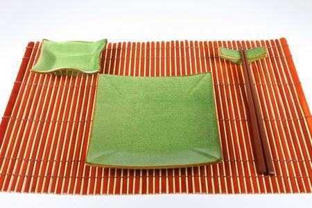 stoneware: Sushi plate and chopsticks on bamboo mat Stock Photo