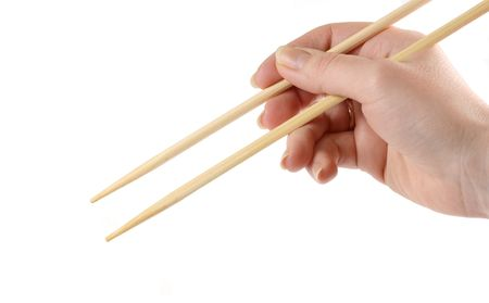 Hand holding the chopsticks isolated on a white background