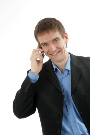 The friendly businessman speaks by phone photo