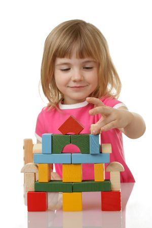 involvement: little girl playing with cubes