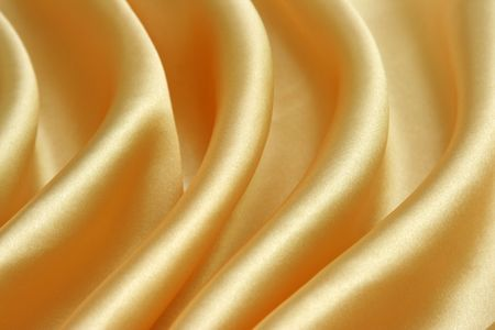 golden fabric can be used as a background Stock Photo - 3810320