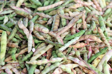 long beans: Long green beans heaped at a market Stock Photo