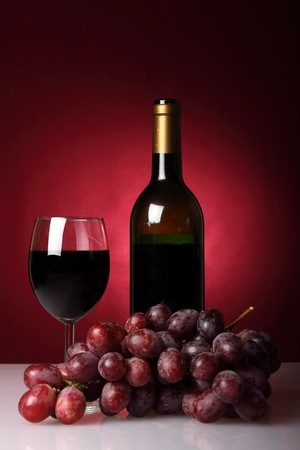 Still-life with red wine  and bunch of grapes photo