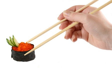 Hand holding the chopsticks isolated on a white background photo