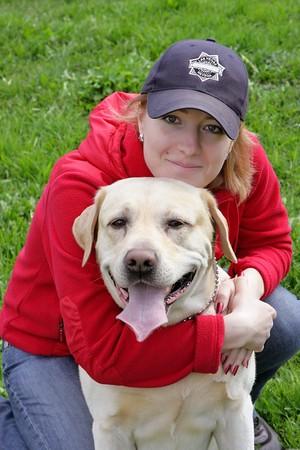 A happy girl hugs a dog Stock Photo