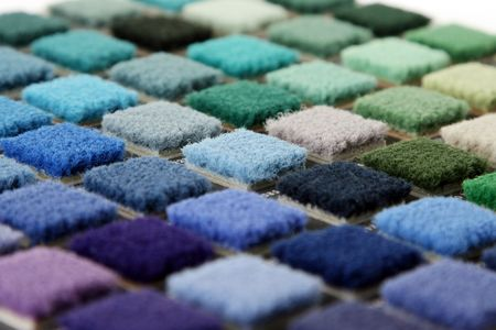 Samples of color of a carpet covering closeup