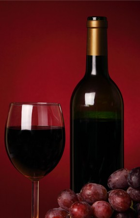 Still-life with red wine and bunch of grapes Stock Photo - 4482648