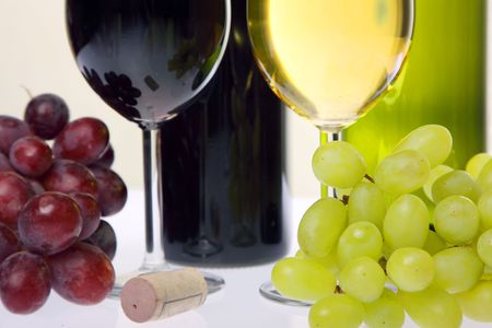 Still-life with wine and bunch of grapes photo