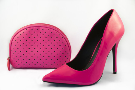 no heels: Pink High Heel Shoe and Pink Purse on White Background Stock Photo