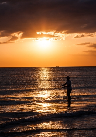 A man Fishing in the Sunset  Anna Maria Island, Florida Stock Photo - 17307127