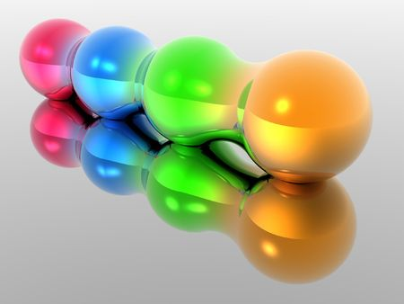 Four different colored spheres morphing together with reflection.